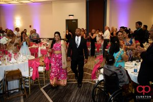 Indian bride and groom making an entrance into the wedding reception at Embassy Suites Greenville.