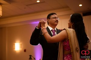 Bride and her father sharing a dance at her wedding.