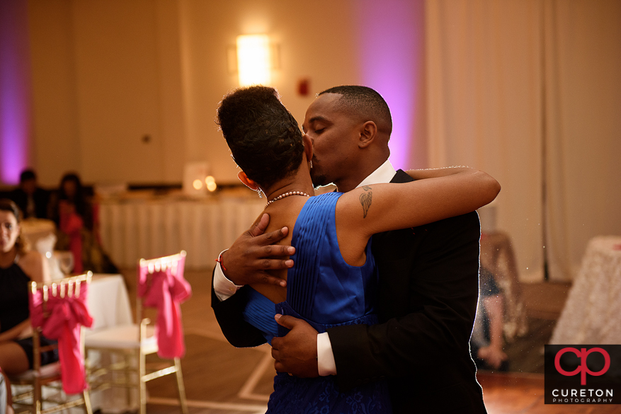Groom and his mother sharing a dance at his wedding.