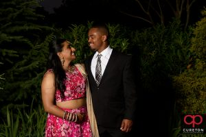 Bride and groom posing outside Embassy Suites Greenville during their wedding reception.