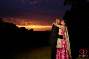 Bride and groom posing outside Embassy Suites Greenville SC during their wedding reception.