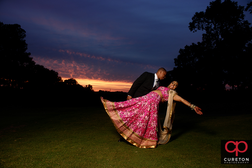 Indian bride and groom sunset portrait on the golf course.