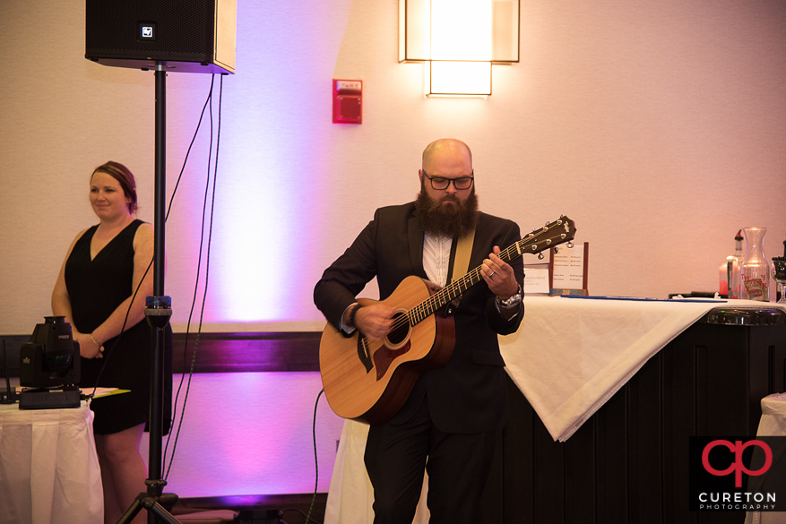 The bride and groom are serenaded to the song At Last.