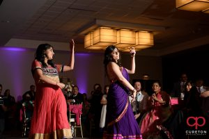 Family members performing for the bride and groom at the Indian Wedding Reception.