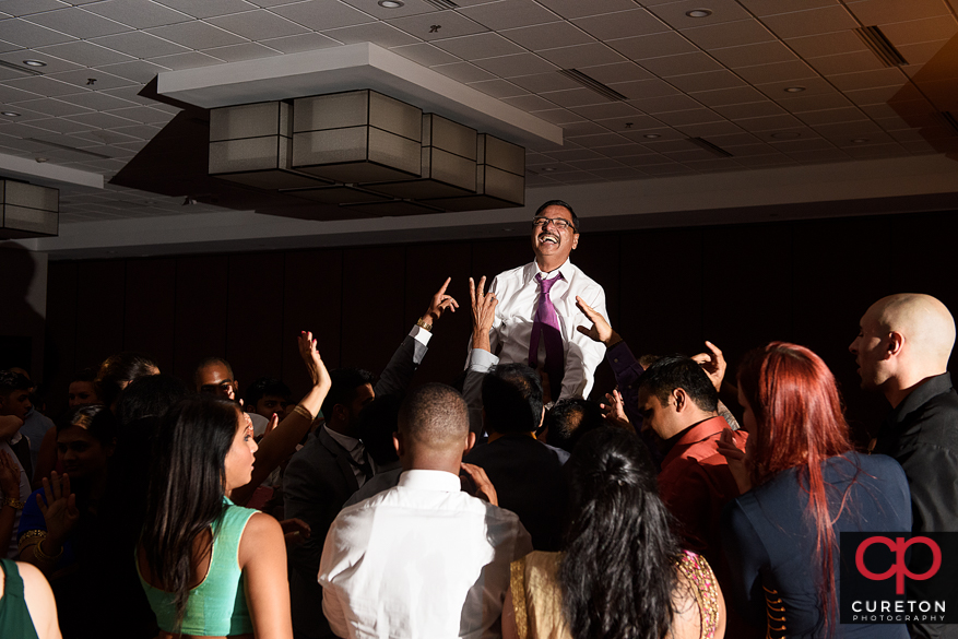 Wedding guests dancing on a packed dance floor in Greenville,Sc to the sounds of DJ Desi.
