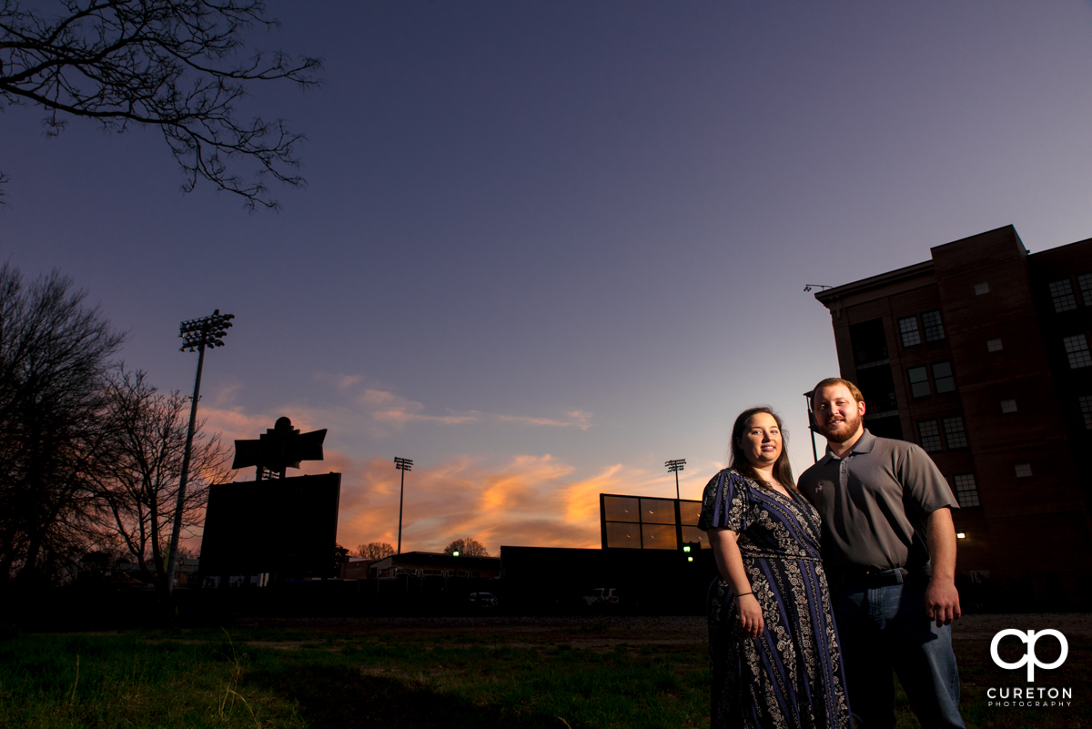 Engaged couple at sunset during a Greenville,SC park engagement session.