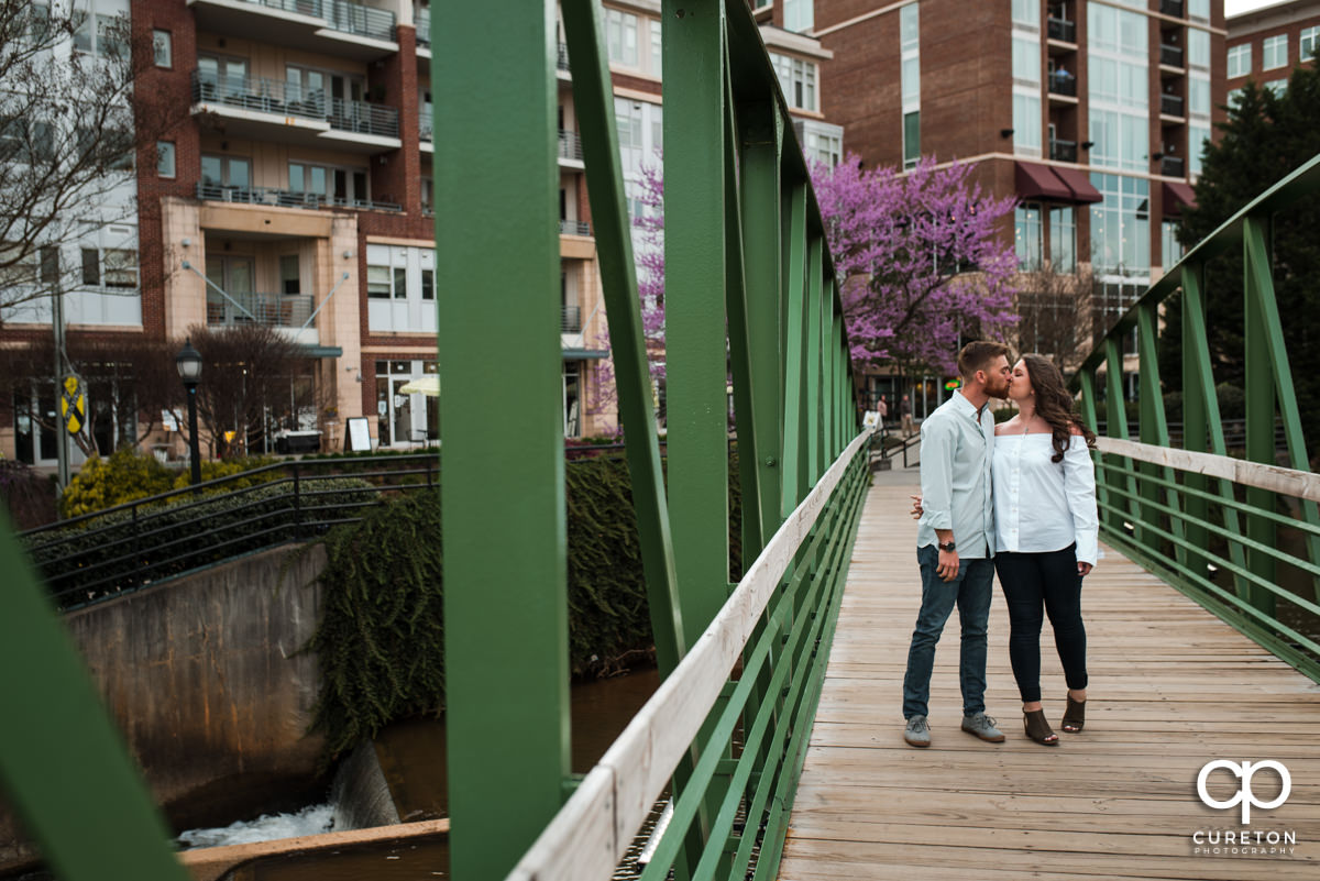 Husband and wife strolling across a bridge in Greenville,SC.