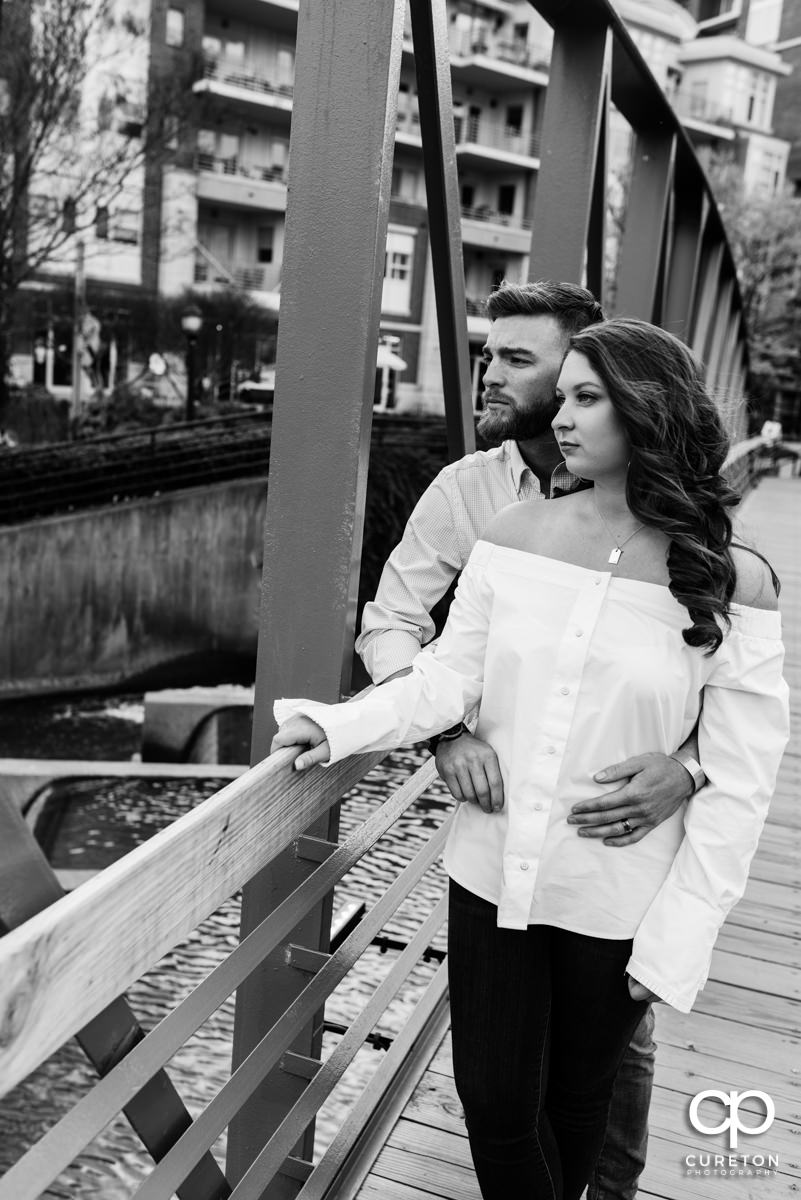 Man and wife looking in the distance during a high fashion Greenville,SC anniversary session.