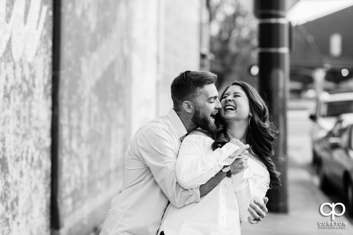 Man and his wife laughing during a Greenville,SC anniversary session.