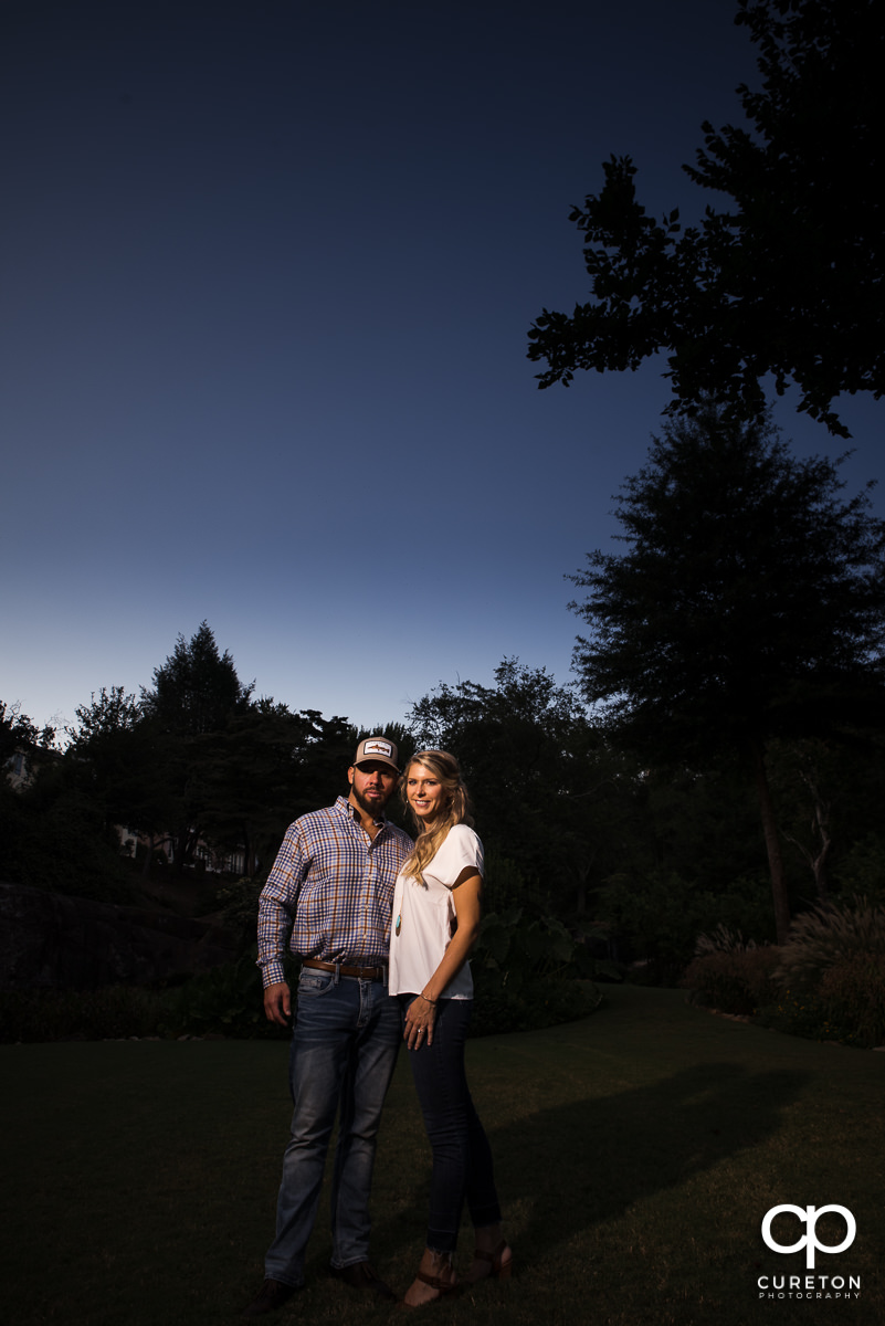 A man and woman in The Rock Quarry Garden at sunset.