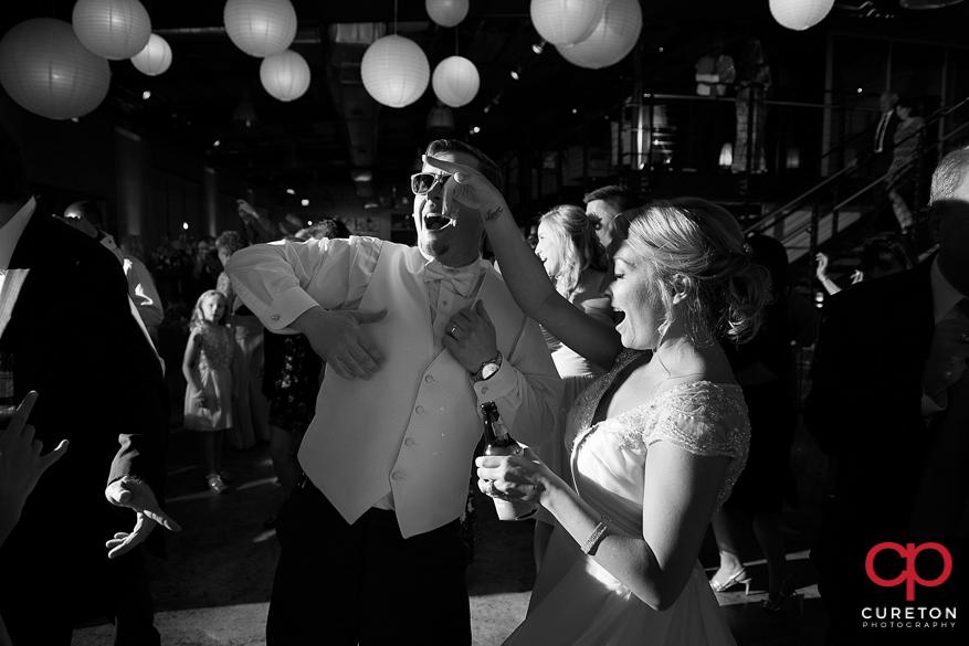 Groom and bride dancing.