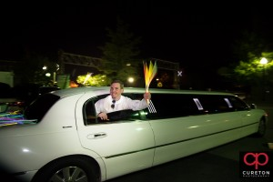 Groom hanging out of the limo