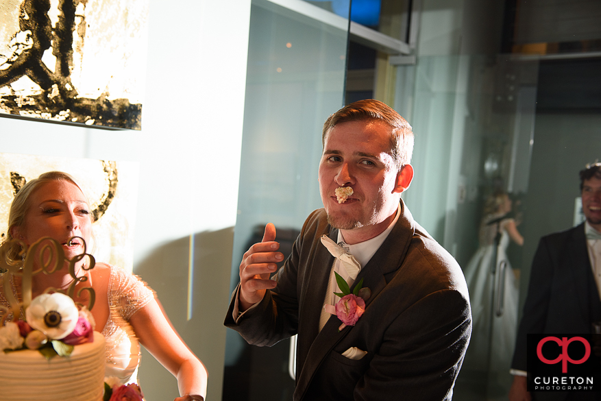 Groom with cake on his face.