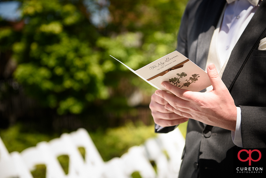 Groom reading his card before the wedding.