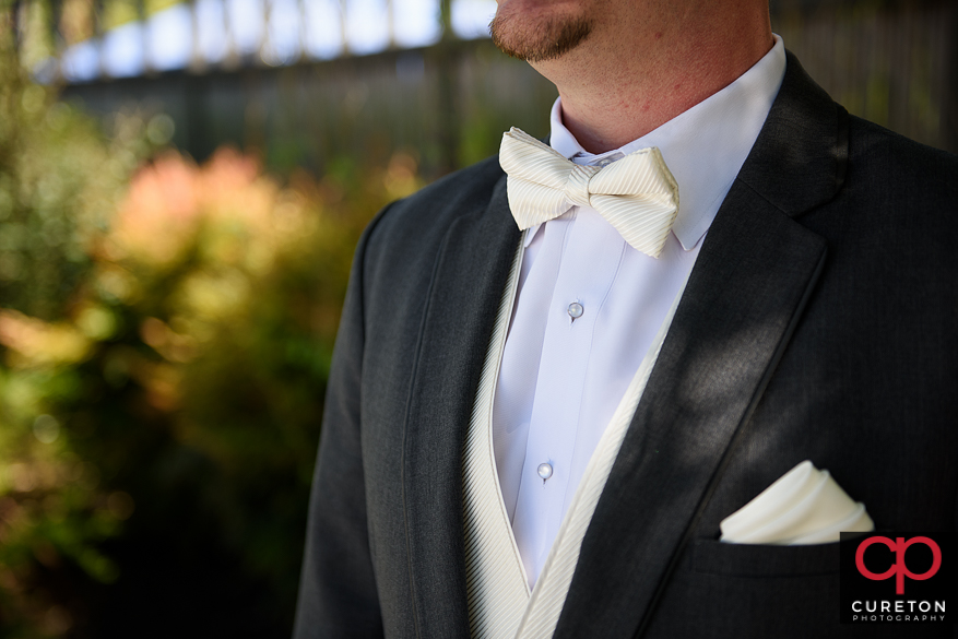 Grooms tie closeup.
