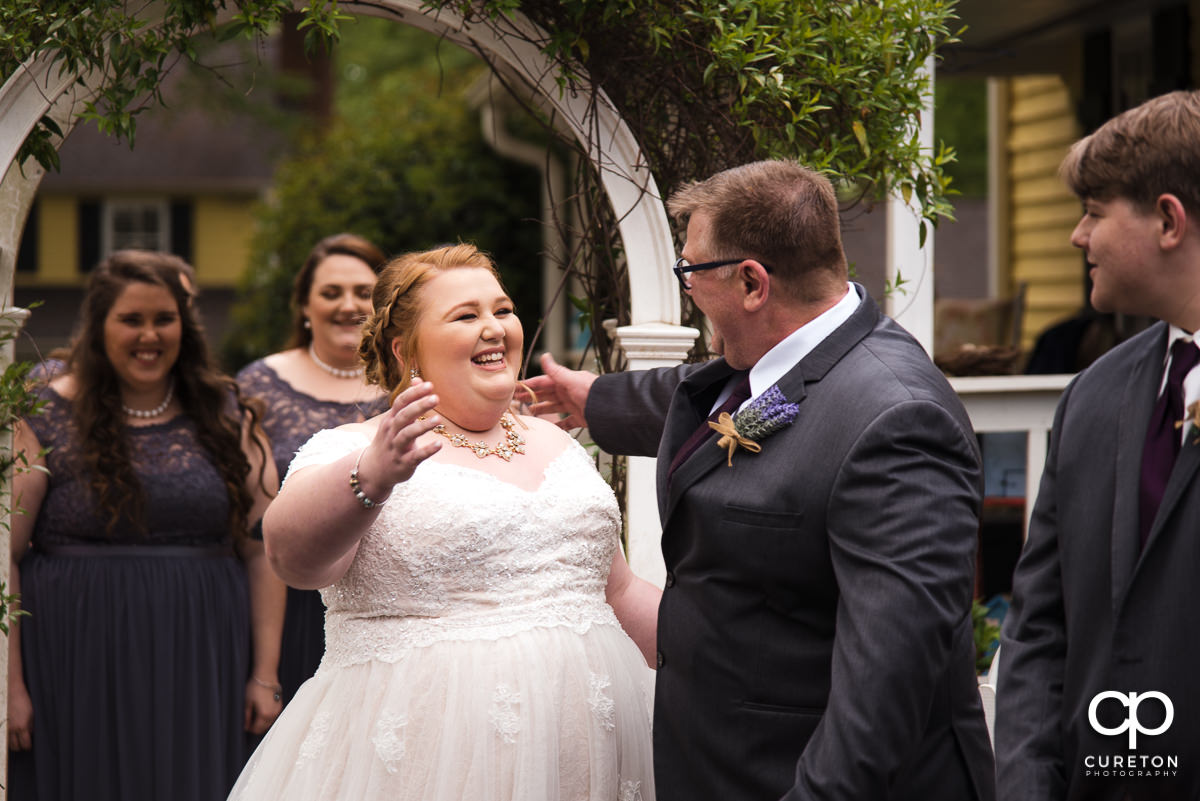 Bride and her father see each other for the first time on the wedding day.