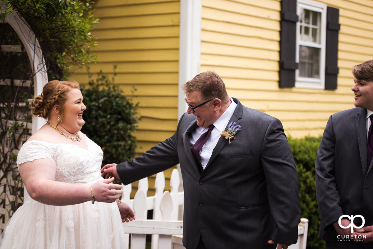 Bride and her father see each other for the first time on the wedding day at the Grove at Pennington.