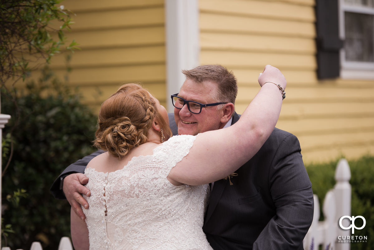 Bride hugging her father before the ceremony.