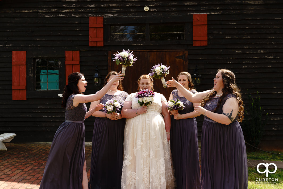 Bridesmaids tossing their flowers back and forth.