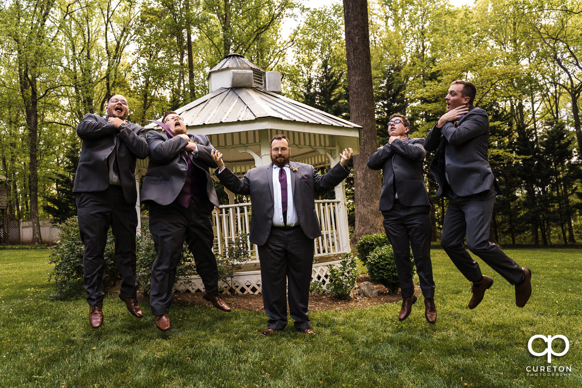 Groom levitating the groomsmen with the force at a Star Wars wedding.