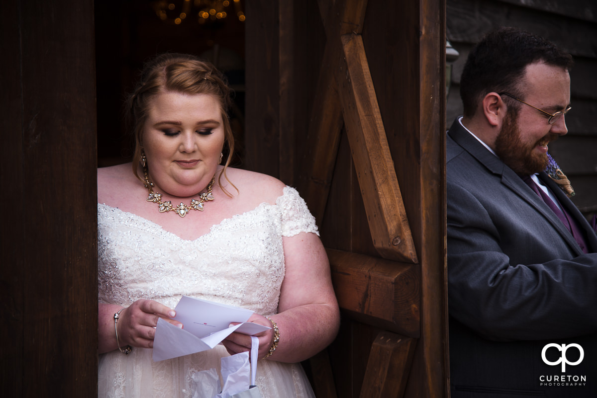 Bride and groom reading letters from each other before the wedding ceremony.