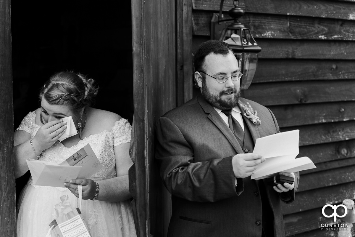 Bride crying as she reads a letter from the groom.
