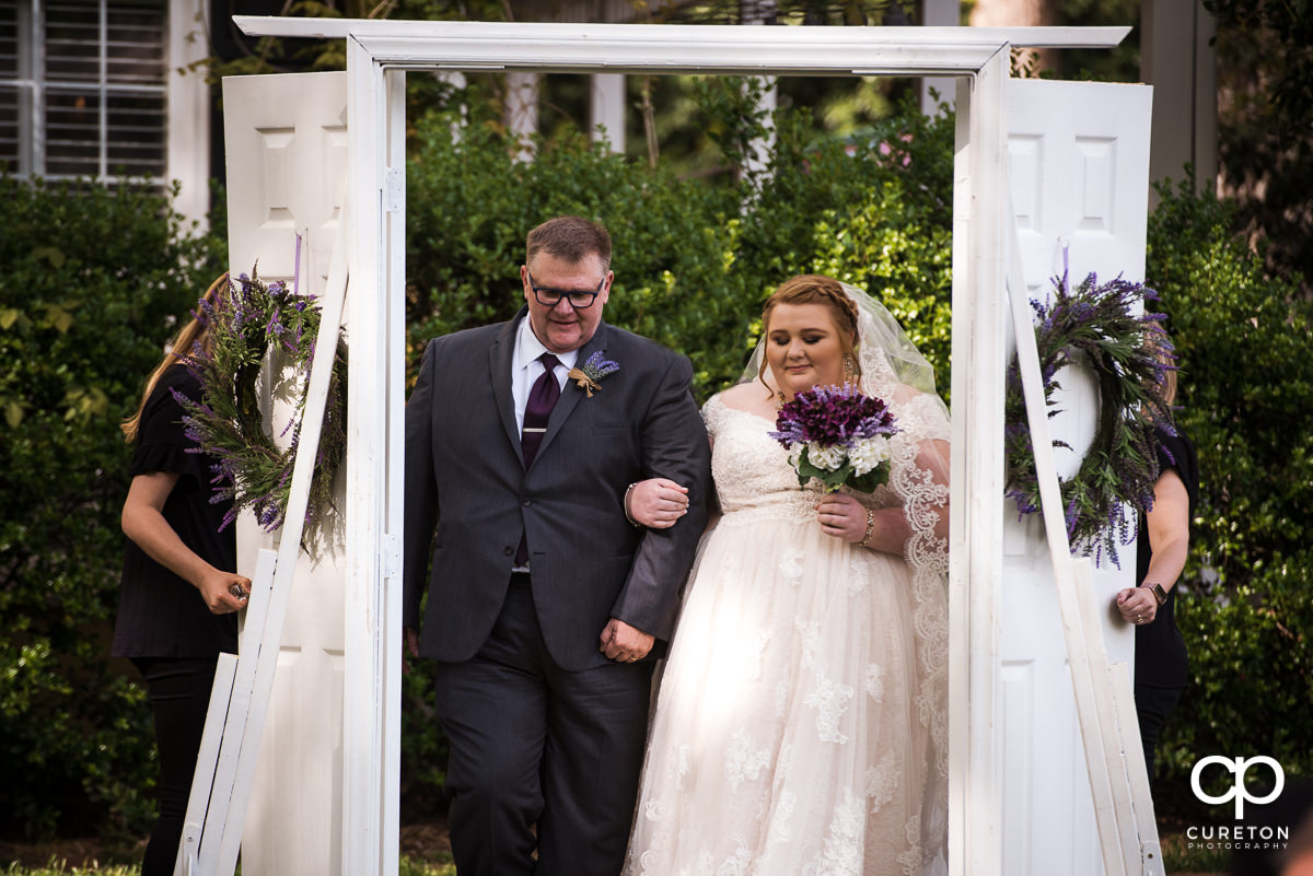 Bride and her father walking down the aisle at the Grove at Pennington wedding.