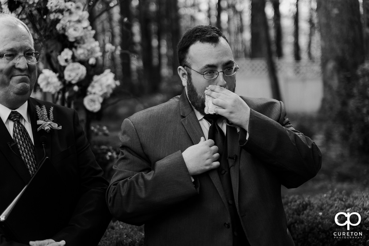 Groom tearing up as he sees his bride walking down the aisle at the Grove at Pennington wedding.