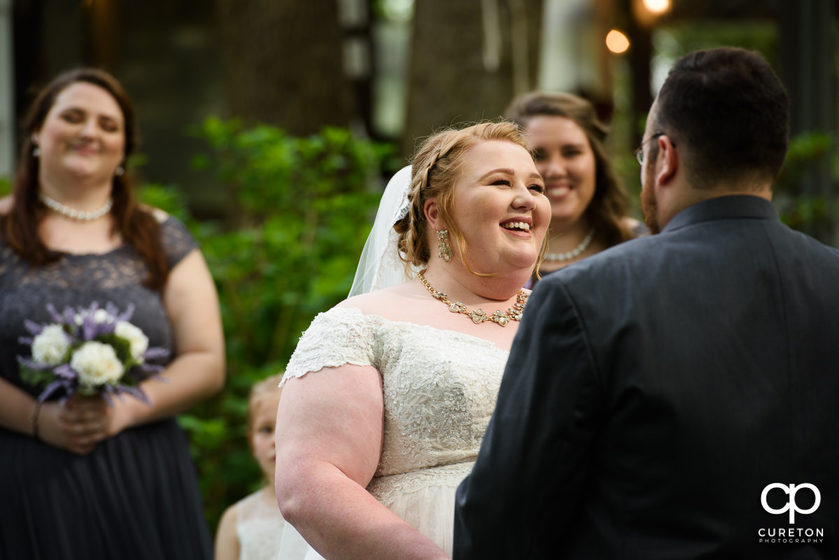 Bride laughing during the ceremony.