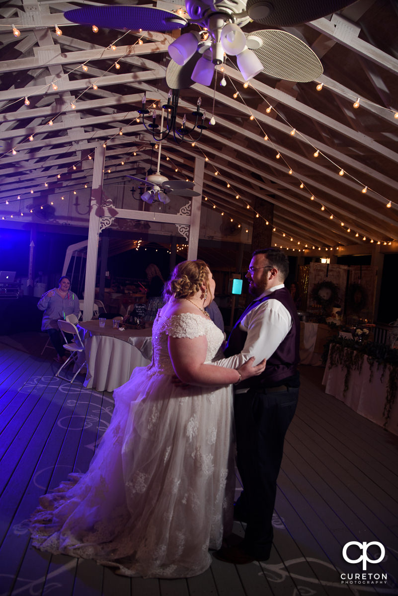 Bride and groom sharing a last dance at the reception.