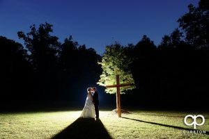 Bride and groom kissing near across at their Hollow at Paris mountain wedding.