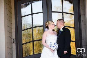 Bride and groom looking at each other after their wedding at the hollow at Paris mountain.
