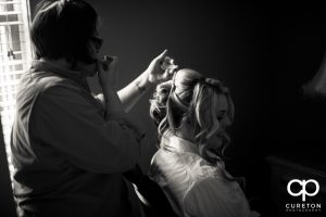 The bride getting her hair done.