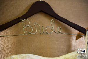 The bride's custom dress hanger.