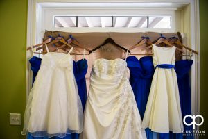 The bride and bridesmaid's dresses hanging up.