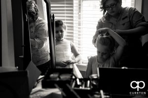 The bride's daughter getting her hair done.
