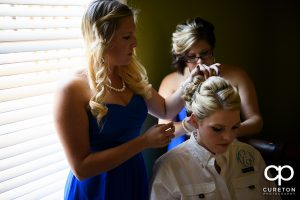 Bride getting her hair and make up done.