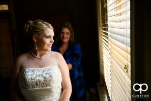 The bride staring out the window.