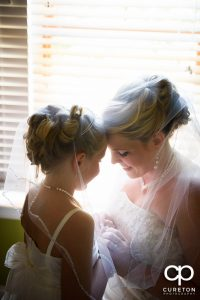 The bride and her daughter sharing a moment before the wedding.