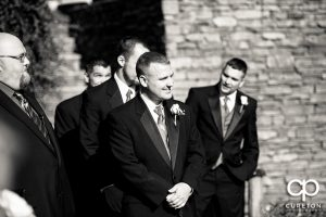 The groom sees his bride for the first time.