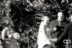 Bride tearing up during the ceremony.