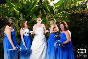 Bride and bridesmaids having fun.