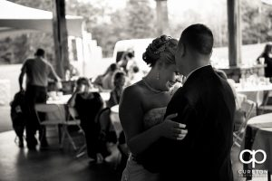 Bride smiling during their first dance.