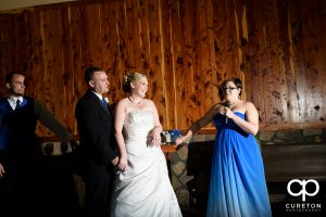 Bridesmaid toasting the newly married couple.