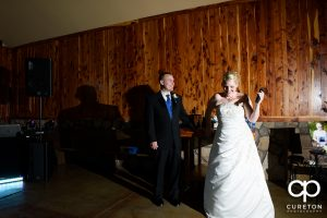 Bride and groom welcoming guests to their wedding.