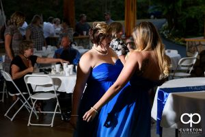 Guests dancing to the sounds of Parker entertainment at the wedding reception.