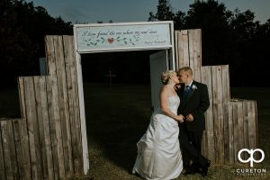 Bride and groom kissing after their wedding at the hollow it Paris mountain.