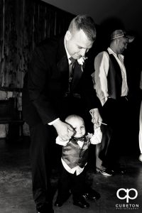 Groom and his son dancing at the wedding.