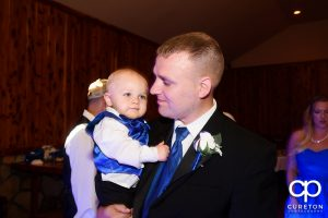 Groom and his son.