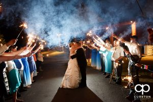 Sparkler leave after the wedding at the hollow at Paris mountain in Greenville South Carolina.